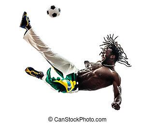 brazilian  black man soccer player kicking football