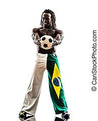 brazilian  black man soccer player holding showing football