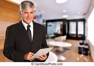 Brazilian business man looking at camera in blurry office background. Copy space.