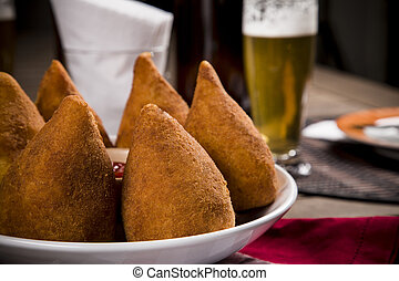 Brazilian Coxinha - Coxinha, a Brazilian snack, with a bar...