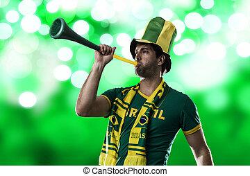 Brazilian Fan Celebrating, on a green background.
