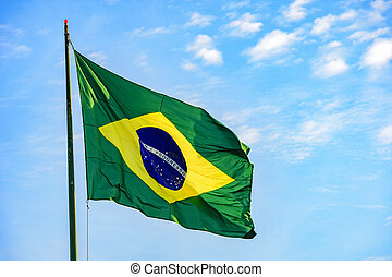 Brazilian flag with blue sky in background