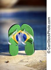 Brazilian flipflop in front of the swimming pool in Brazil