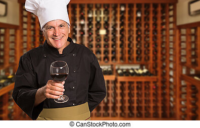 Brazilian kitchen chef with wine glass in hand in a wine house blurred in the background.