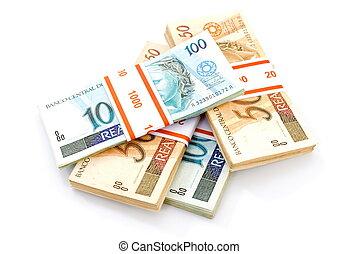 Brazilian Money - Brazilian Real currency on white .