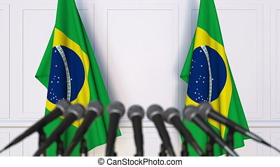 Brazilian official press conference. Flags of Brazil and...