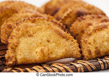 Brazilian Pastel - Pastel, a Brazilian snack, in a white...