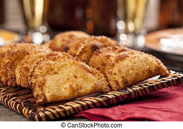 Brazilian Pastel - Pastel, a Brazilian snack, with a bar in...