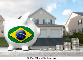 Brazilian real estate investment concept with piggy bank, stacks of coins and house in the background