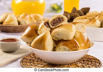 Brazilian snack. Meat Esfiha portion. - Brazilian snack....