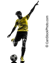 brazilian soccer football player young man kicking...