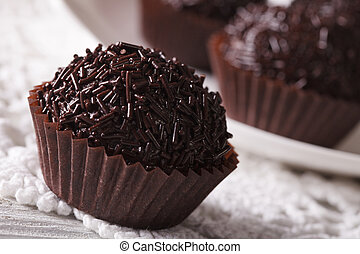 Brazilian truffle candy Brigadeiro macro. horizontal -...