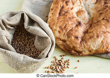 Bread and a bag of grain on the boards