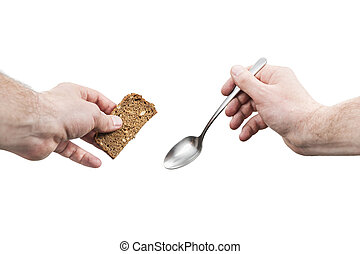 Bread and a spoon in male hands