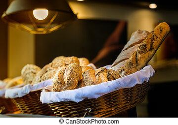 Bread and buns inside wicker basket