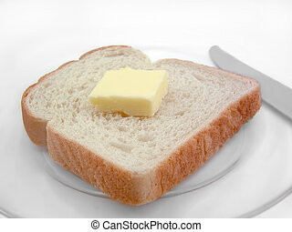 Bread and Butter - A slice of bread with butter isolated on ...
