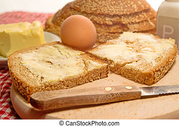 Bread and butter on a table, served for breakfast