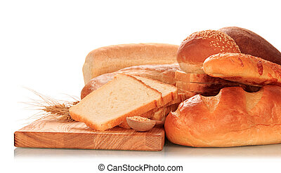 Bread and ears of wheat - Bread loaves and ears of wheat on...