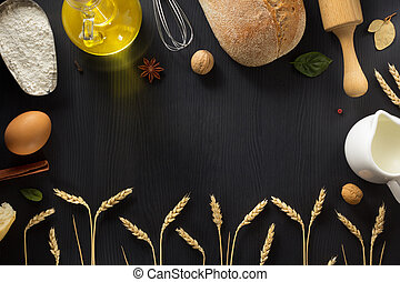 bread and ears of wheat  on wood