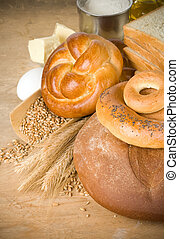 bread and grain on wood background