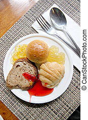 Bread and Jam in white dish.