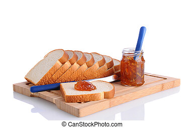 Bread and Marmalade - Closeup of bread on a cutting board...