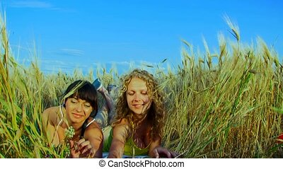 Bread And Milk - Two charming young women are at the wheat...
