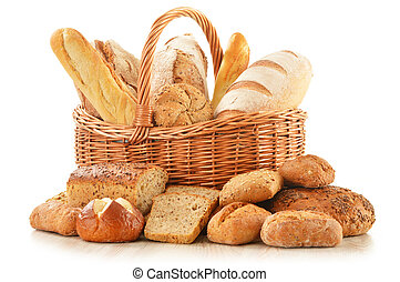 Bread and rolls in wicker basket isolated on white -...
