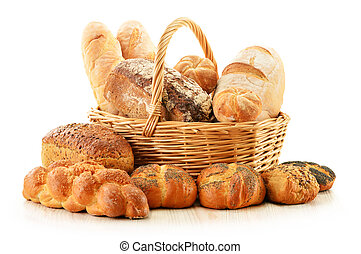 Bread and rolls in wicker basket isolated on white - ...
