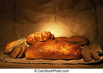 bread and wheat on sacking still-life