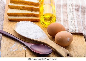bread and wheat on the wooden background