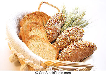 Bread - Assortment of baked bread with wheat isolated on...