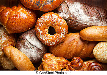 Bread assortment on wooden table background