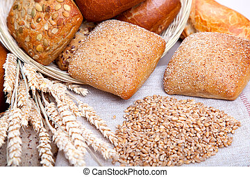 Bread, bread grain and ears bunch. still life on rustic background