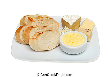 Bread cheese and butter on a plate isolated against white