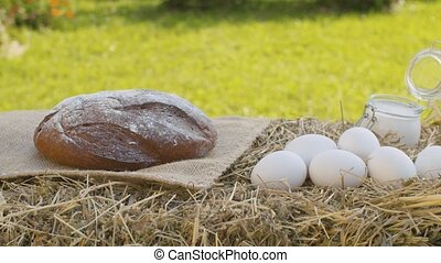 Bread, chicken eggs and sour cream - Close up sour cream, ...