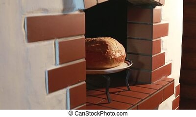 Bread comes out of the oven