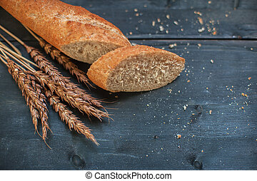 Bread composition with wheats. Very shallow DOF photo and...