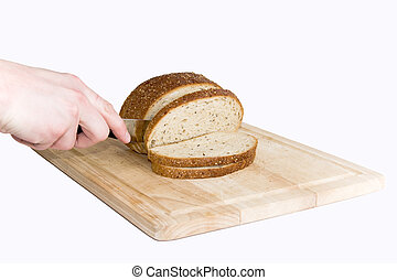 Bread cut by knife on kitchen board