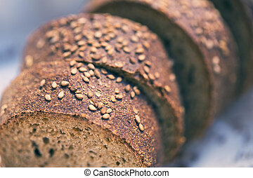 Bread cut into slices of Monreale, macro, focus selected