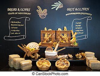 Bread display - Display of bread variety on shelves in ...