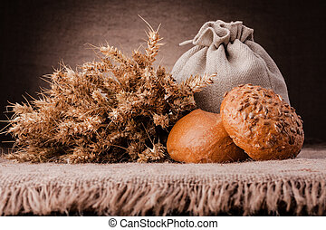 Bread, flour sack and ears bunch still life