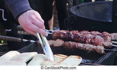 Bread for toast and Kebab prepared on the grill.