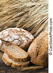 Fresh beautiful bread on wooden background close up shoot