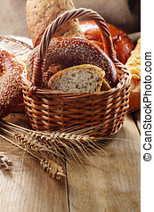 Bread - Group of bread loaves, buns, rolls on the wooden...