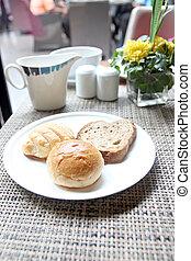 Bread in a white dish.