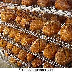 Bread in Bakery - Shelves of fresh baked loaves of artisan...