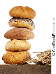 Bread loaf and buns on a shelf - Bread loaf, buns and rolls...