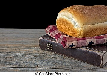 bread loaf on Bible