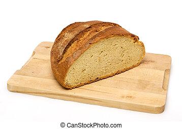 bread loaf on wooden cutting board